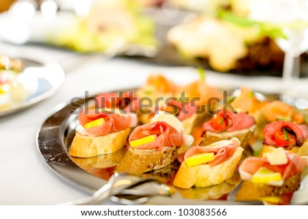 Catering canapes tray food details appetizers for special business events - stock photo