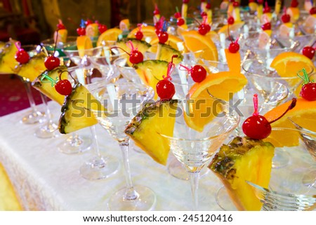 Catering - empty decorated cocktail glasses ready for pouring. Closeup - stock photo