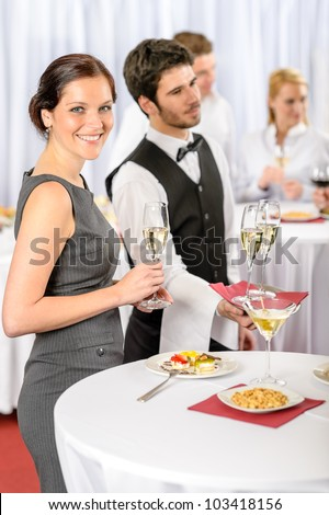 Catering service at business meeting offer champagne aperitif to woman - stock photo