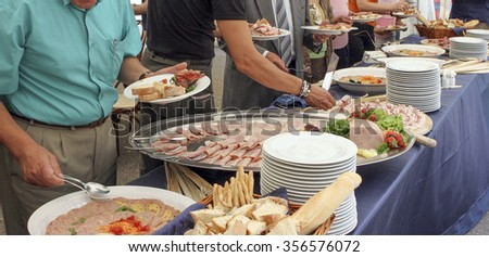 catering service, people self serving on a buffet  - stock photo