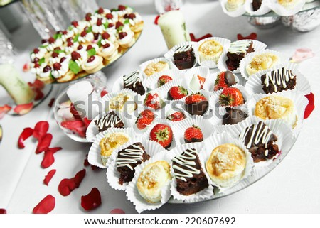 catering service sweets strawberries with chocolate at party - stock photo