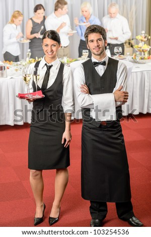 Catering service waiter, waitress business event serving drinks to guests - stock photo