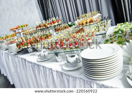 catering services background with snacks on guests table in restaurant at event party - stock photo
