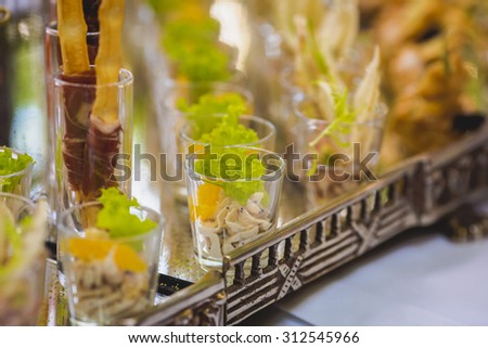 catering services background with snacks on guests table in the restaurant