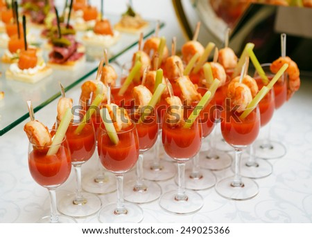 Catering - snack coctails with tomato juice and shrimps - stock photo