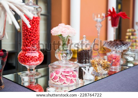 catering sweets, Dessert table for a party. Ombre cake, cupcakes, sweetness and flowers - stock photo