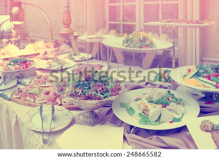 Catering table full of food, no people, toned image - stock photo