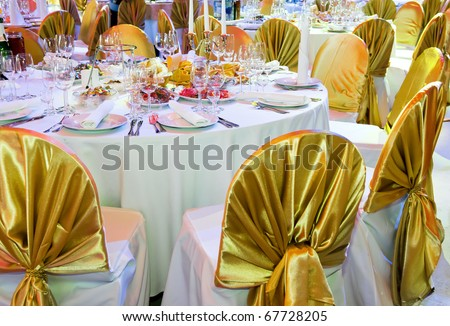 catering table set service with dish silverware and stemware glass at restaurant before party - stock photo