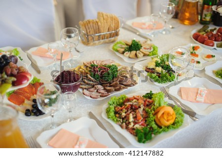 catering table set service with silverware and glass stemware - stock photo