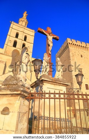 Cathedral and christian cross at evening in Avignon, Provence, France - stock photo