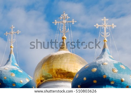 Cathedral domes of a Dormition Cathedral (1585) in a winter sunny day, Trinity Lavra of St. Sergius, Sergiyev Posad, Russia