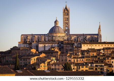 Cathedral in the old town of medieval Siena at sunset. - stock photo
