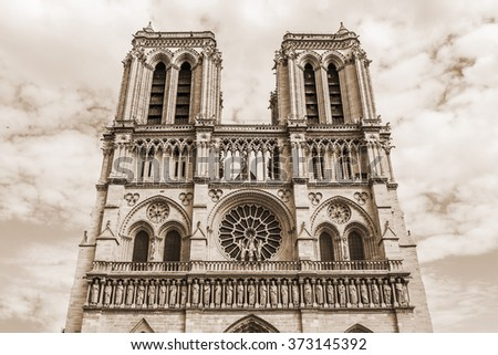 Cathedral Notre Dame de Paris - a most famous Gothic, Roman Catholic cathedral (1163 - 1345) on the eastern half of the Cite Island. France, Europe. Vintage, sepia. - stock photo