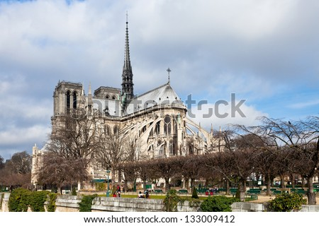 cathedral Notre Dame de Paris in cloudy day - stock photo