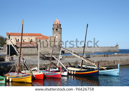 Cathedral Notre-Dame-des-Anges and catalan fishing boats in Collioure, France - stock photo