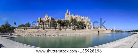 Cathedral of la Seu Majorca in Palma de Mallorca reflection over lake at Balearic islands Spain - stock photo