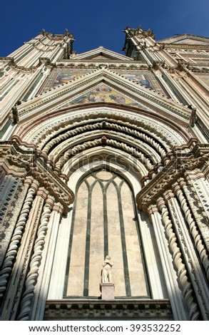 Cathedral of Orvieto in Umbria in Italy. Detail of the facade in the Gothic style - stock photo