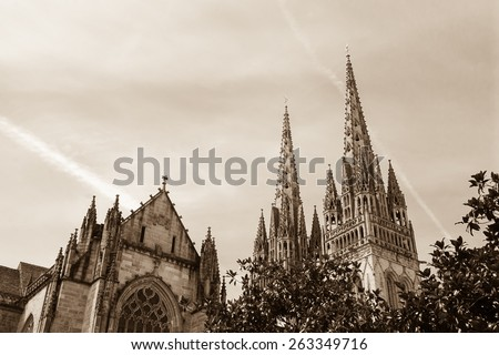 Cathedral of Quimper. Brittany, France. Aged photo. Sepia. - stock photo