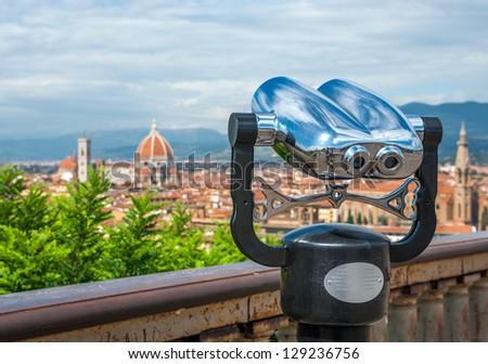 Cathedral of Santa Maria del Fiore (Duomo) and basilica of Santa Maria Novella in front of touristic binoculars, Florence city, Italy - stock photo