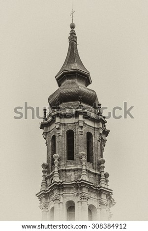 Cathedral of Savior (Catedral del Salvador or Cathedral La Seo) - Roman Catholic cathedral in Zaragoza, Spain. Cathedral is part of World Heritage Site Mud?jar Architecture of Aragon. Antique vintage. - stock photo