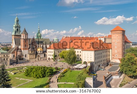 Cathedral of St Stanislaw and St Vaclav and royal castle on the Wawel Hill, Krakow, Poland on sunny afternoon - stock photo