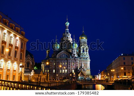 Cathedral of the Resurrection on Spilled Blood (Church of Our Savior on the Spilled Blood) in St. Petersburg at night in the light of the lanterns - stock photo