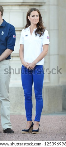 Catherine, Duchess of Cambridge welcomes the olympic torch to Buckingham Palace, London, UK. July 26, 2012. - stock photo