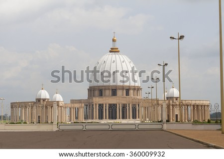"Catholic Basilica of Our Lady of Peace (Basilique Notre-Dame de la Paix) in Yamoussoukro, Cote d'Ivoire. Guinness World Records lists it as the largest ""church"" in the world. Stock photo. - stock photo"