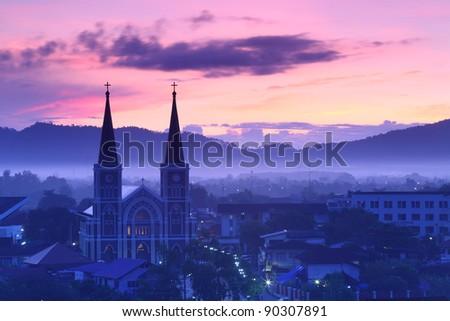 Catholic Church with a beautiful sunrise in Chantaburi province, Thailand. - stock photo