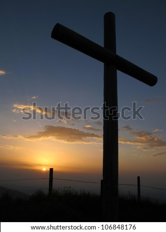 Catholic cross on the summit of a mountain - stock photo