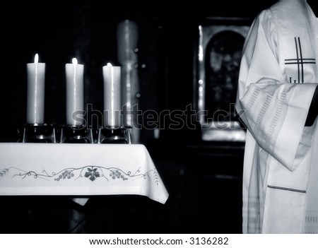 Catholic Priest and the  altar during  Mass , black and white photo - stock photo