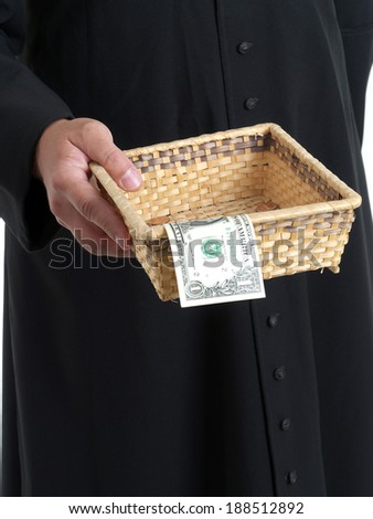 Catholic priest with collection plate - stock photo