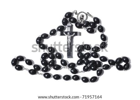 Catholic rosary with crucifix isolated on white background closeup - stock photo