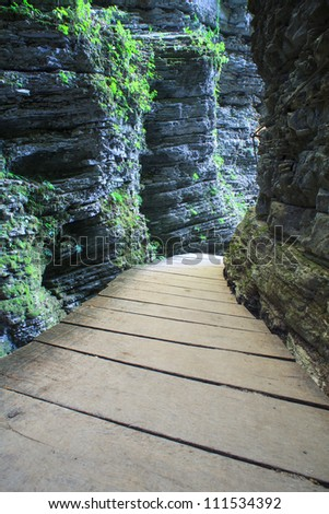 Catwalk in the forest next to the Kozjak waterfall - stock photo