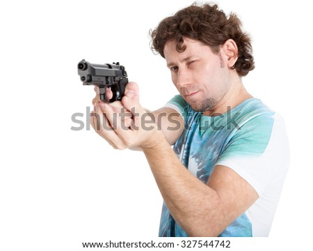 Caucasian adult man aiming with black gun in hands, isolated on white background - stock photo