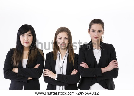 Caucasian and Chinese business women wearing office suits. Isolated on white background. - stock photo