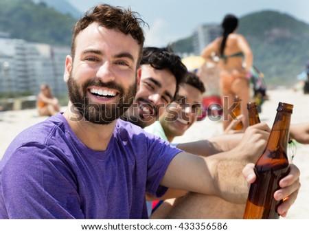 Caucasian at party at beach - stock photo