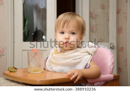 Caucasian blonde little girl eating making dirty herself