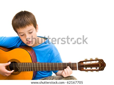 caucasian boy learning to play acoustic guitar, isolated on white background; horizontal crop - stock photo