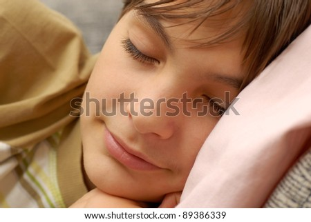 caucasian boy portrait, sleeping with arm under cheek