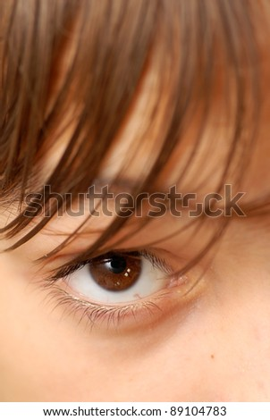 caucasian boy's brown eye