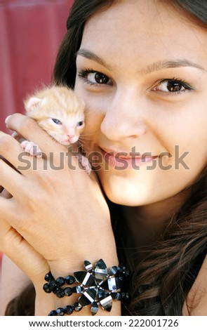 caucasian brunette teen girl with a little kitten - stock photo