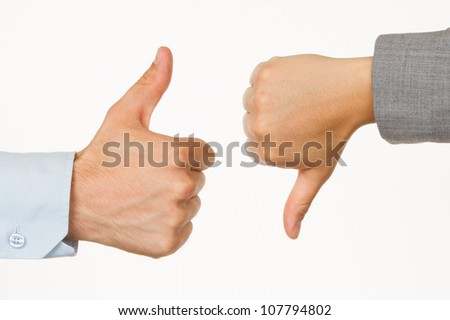 Caucasian business man and woman holding thumb up against white background - stock photo