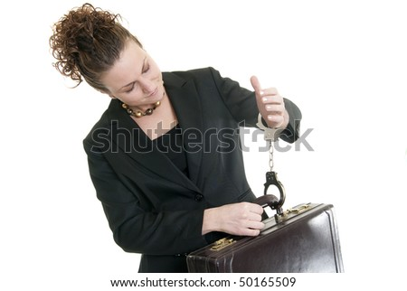 Caucasian business woman holding a briefcase while handcuffed to it. - stock photo