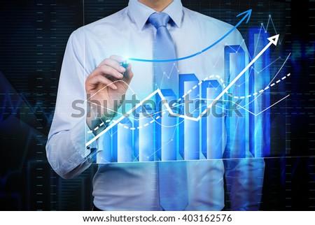 Caucasian businessman drawing forex bar graph - stock photo