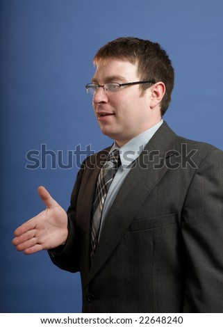 Caucasian businessman in suit offering a handshake - stock photo