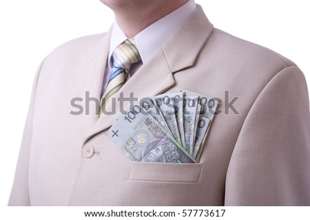 Caucasian businessman in white suit, and pocket full of money. White background.