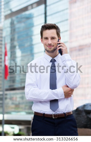 Caucasian businessman talk to cellphone