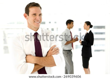 Caucasian businessman with partners in the background - stock photo
