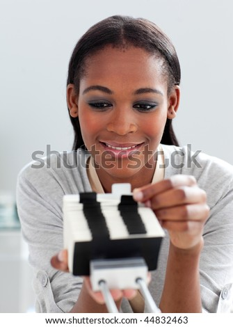 Caucasian businesswoman holding a business card